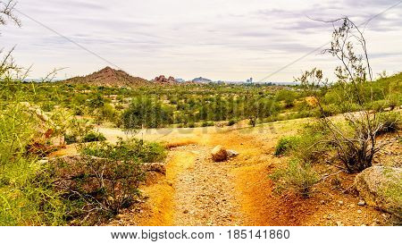 Hiking trail around the red sandstone buttes of Papago Park in the city of Tempe Arizona, United States
