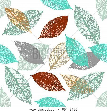 A seamless background pattern of vector skeleton leaves in teal blue and rusty brown, autumnal repeat print