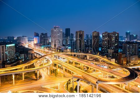 chengdu overpass at night with modern city skyline