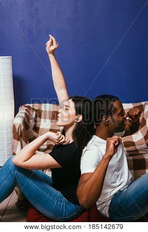 Couple International Man Woman Home Black White Music Earphones Enjoy Fun Energetic Gesture Dance Leisure Concept