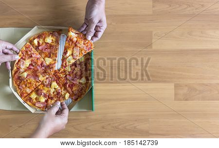 Pizza Ready To Eat Shot  Pizza People Hands Eating From Delivery Box