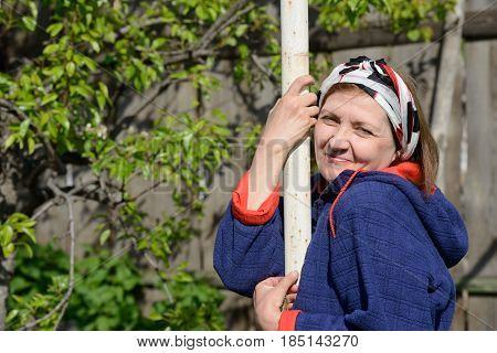 Outdoor Portrait Of Aged Smiling Woman In Bright Sunlight.