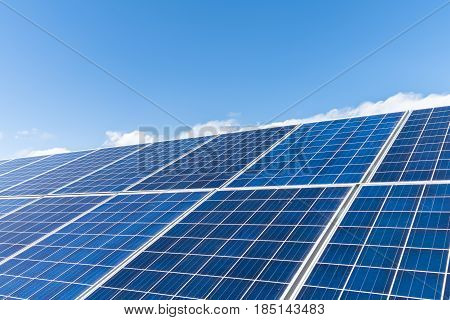 closeup of the solar energy panels with sunny sky