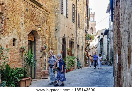 Couples enjoy an afternoon stroll on Corso il Rosselino in Pienza, Tuscany, Italy - 3 October 2011