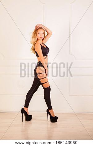 Beautiful blond in black clothes