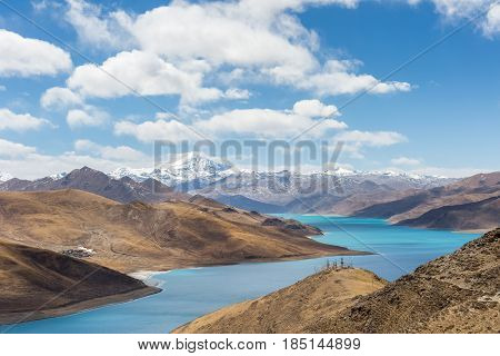 holy lake with snow mountain against a blue sky on tibet plateau