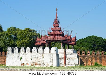 The ancient bastion of the old city close up on a sunny afternoon. Mandalay. Burma