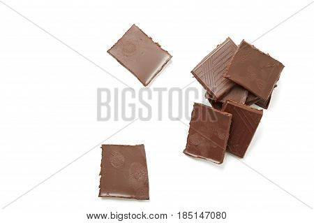 Dark milk chocolate bars isolated on a white backgroundThe hot melt
