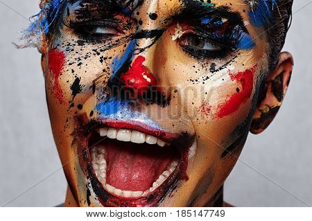 Insane laughing evil Clown with creative Halloween Face Art