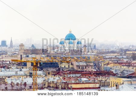 Industrial landscape in overcast orthodoxy day and temple with blue domes