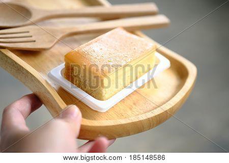 Custard cake on the hand in the coffee shop