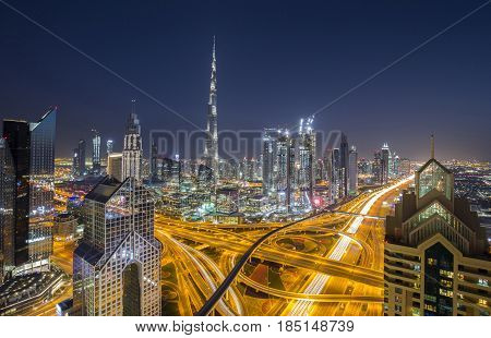 Dubai skyline with the tallest building in the world Burj Khalifa near busy Sheikh Zayed Road in the evening during the twilight