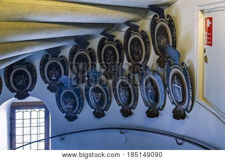 HILLEROD, DENMARK - JUNE 30, 2016: The noble coats of arms decorate the passages and piers of the Frederiksborg Castle.