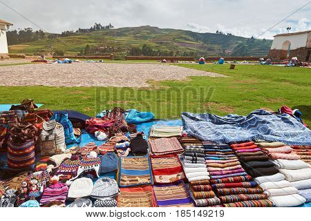 Traditional peruvain clothes market on green mountain hills background