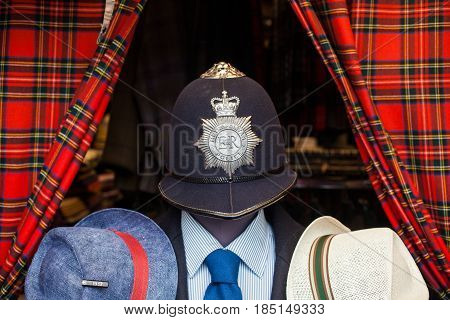 MILAN, ITALY - APRIL, 22: Traditional british helmet of metropolitan police and other hats on April 22, 2017