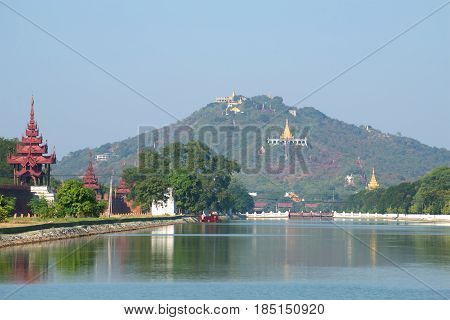A view of the sacred hill of the city of Mandalay in the morning haze. Burma