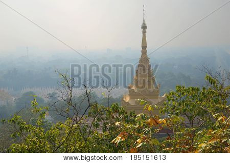 Morning mist over the city of Mandalay. View from the Sacred Hill. Burma
