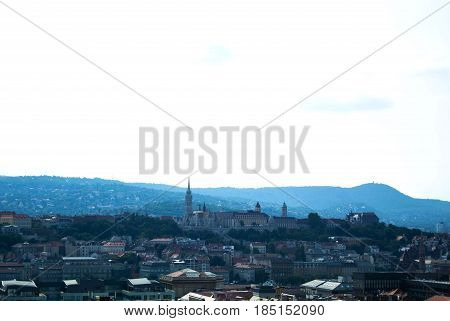 Panoramic View Of Budapest, Matthias Church In Front Of The Fisherman's Bastion At The Heart Of Buda