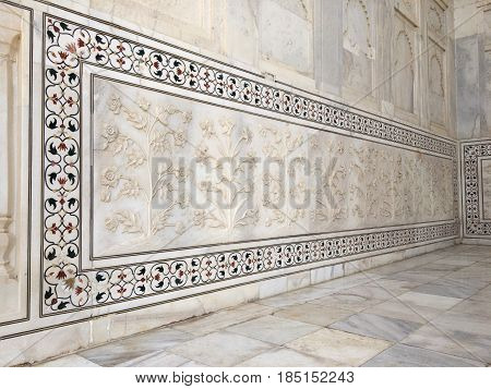 Details of Taj Mahal architecture on white marble background Agra Uttar Pradesh state India