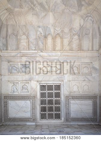 Details of Taj Mahal architecture at the entrance on white marble background Agra Uttar Pradesh state India