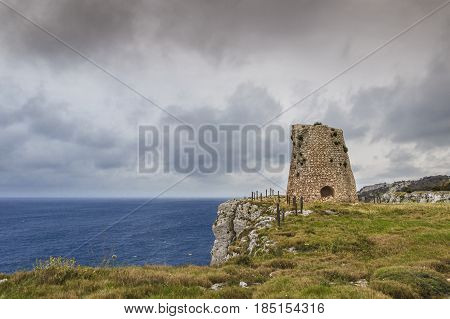 Salento coastline: Minervino watchtower. This medieval ruin is located in The Otranto Santa Maria di Leuca Coast and Tricase Woods Regional Nature Park.Italy (Apulia).