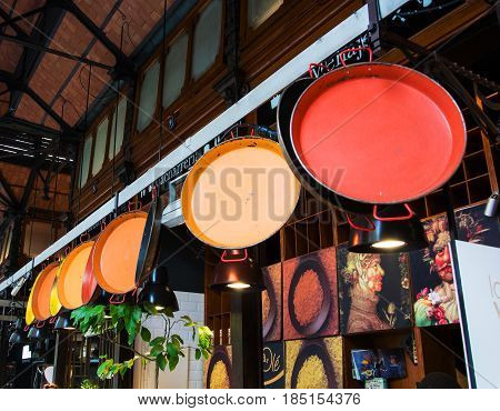 MADRID SPAIN - FEBRUARY 12 2017: Paella pans at San Miguel market at the center of Madrid Spain.