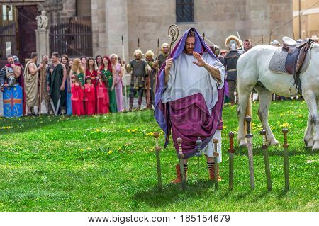 ALBA IULIA ROMANIA - APRIL 29 2017: Priest Roman praying in ancient costum and rituals in one demonstration at APULUM ROMAN FESTIVAL organized by the City Hall.