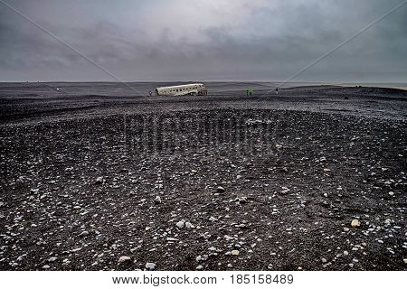 Abandoned airplane wreck in black sands in Iceland,