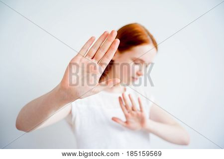 Girl is covering her face with her hand