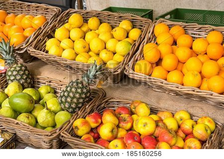 Fresh fruits in baskets for sale at a market