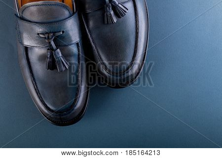 Blue loafer shoes on blue background. One pair. Top view