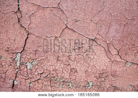 Damaged surface of the facade of a house