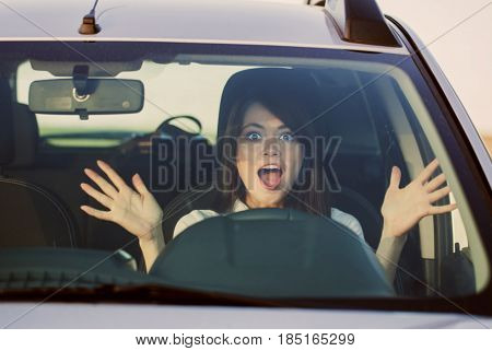 the scared woman shouts driving the car