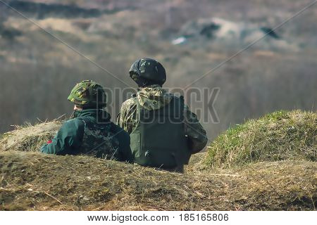 Front Line. Military attack on battlefield with guns from ambush