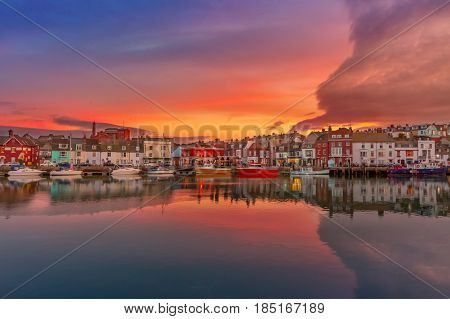 Fishing harbour at sunset in Weymouth Dorset UK