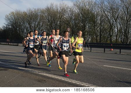 FREDERICIA DENMARK - MAY 6 2017: Leading male group runners Gert-Jan Wassink Thijs Nijhuis Cameron Milne Jesper Faurschou. Little Belt Half Marathon Race Denmark. May 6 2017.