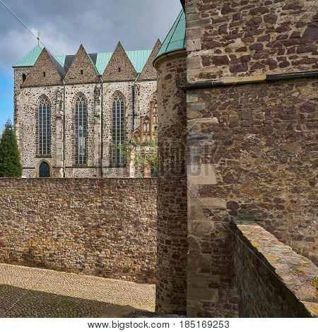 Petri church in the old town of Magdeburg with parts of the historic city wall