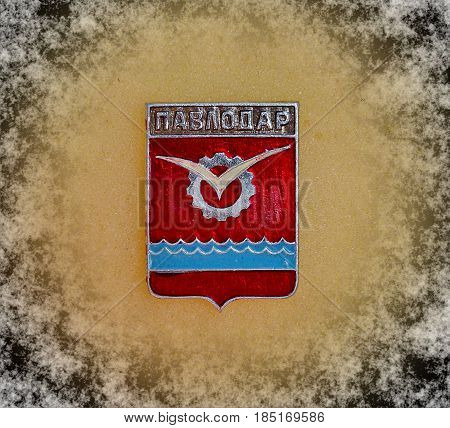 USSR - circa 1977: Badge with the coat of arms of the city of Pavlodar, from the series