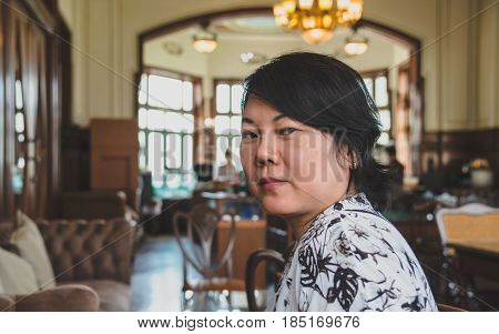 Asian Women Smile In Coffee Shop Vintage Style
