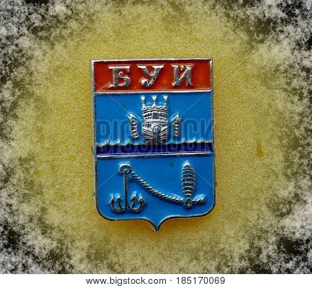 USSR - circa 1977: a badge with the coat of arms of the city of Buoy, Kostroma region from the series
