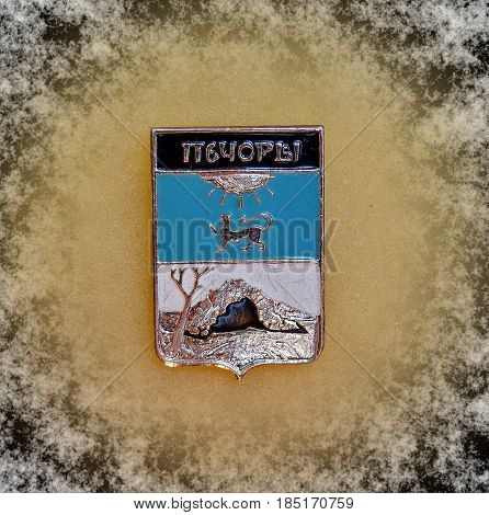 USSR - circa 1977: Badge with the coat of arms of the city of Pechory, Pskov region from the series
