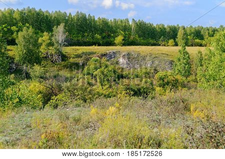 Mountain summer background of Ustinovskii Canyon in Southern Urals, Russia - summer mountain landscape with summer forest trees in sunny summer day.Forest summer nature in the mountain canyon