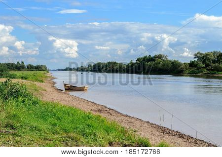 Summer water landscape view of Sievers channel - fairway in Veliky Novgorod region in summer sunny day. Summer nature background. Beautiful summer landscape view of channel waters -summer water landscape