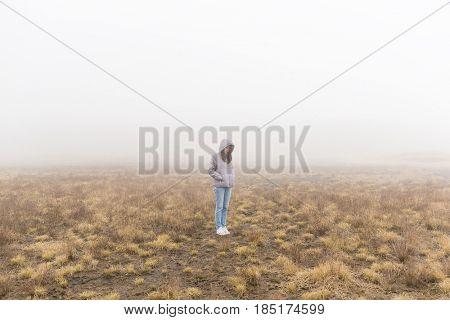 Woman inside the fog