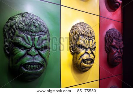 Khabarovsk Russia - May 1 2017: Hulk face colorful wall decoration at an amusement park. Comics character angry portrait in green yellow and red colors