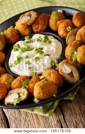 Fried Olives In Breading Stuffed With Almonds Close-up On A Plate. Vertical