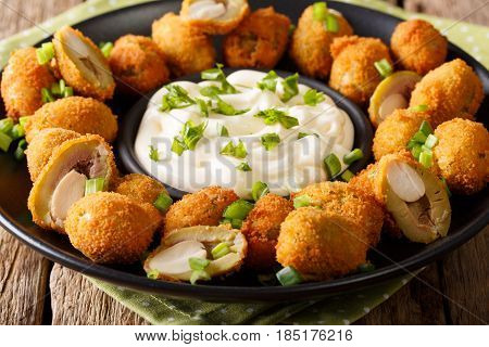 Fried Olives Stuffed With Almonds Close-up And Cream Sauce. Horizontal