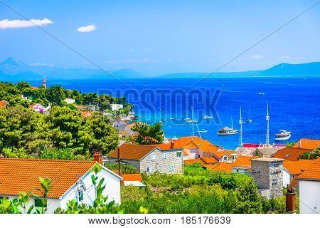 Aerial view at mediterranean town on Island Brac, town Bol seascape during summertime in Croatia, european travel resorts.