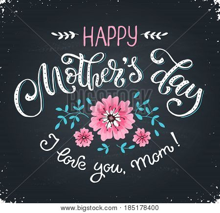 Happy Mothers Day greeting card. I love you mom text with flowers hand drawn on blackboard. Hand drawn lettering in tender colors.