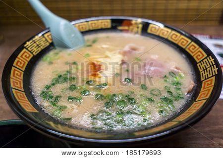 tonkotsu ramen bowl in osaka japan. Traditional famosu tonkotsu ramen in ichiran osaka.